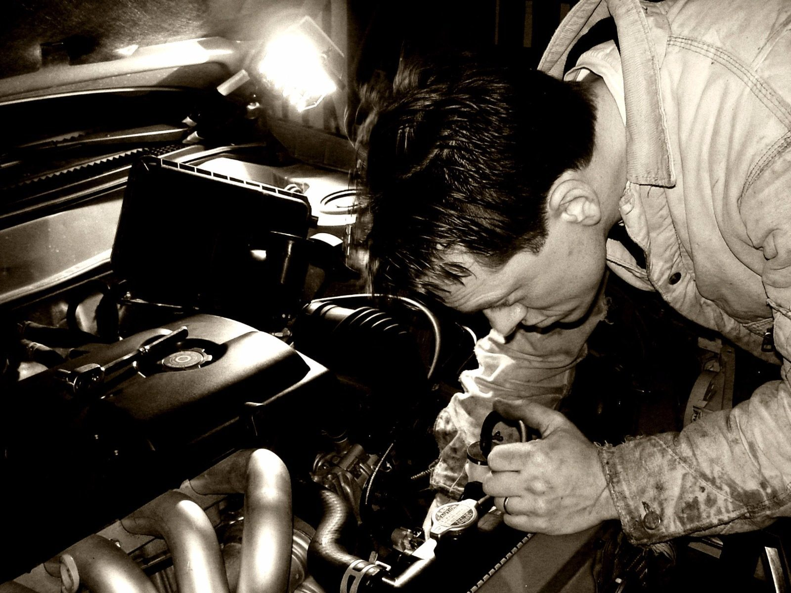 Mechanic working on auto engine